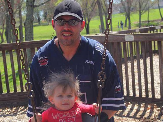 Buddy and Aubrey Bain swing in park