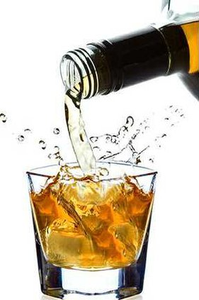 bottle-of-alcohol-pouring-into-glass-with-splash