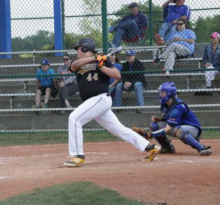Brady Hughes gets the bat on a ball against the Wildcats. RV