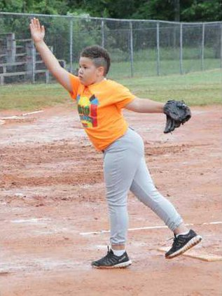 Izayah Dowell works the mound for the Big bounce in co-ed softball action at Bill Page Ball Park last week..JPG