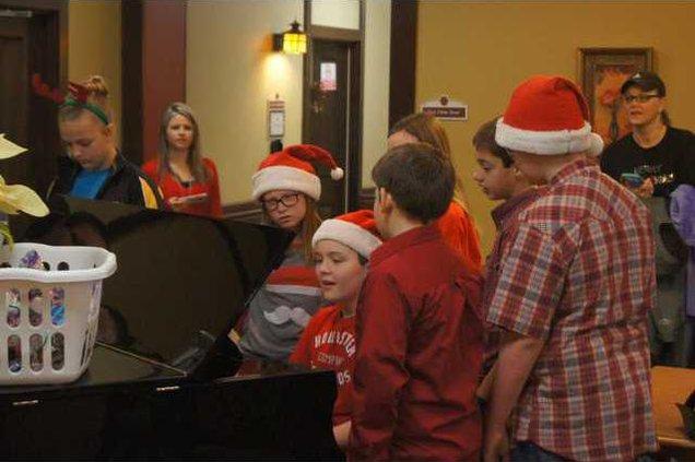 garrett plays piano at Webb House