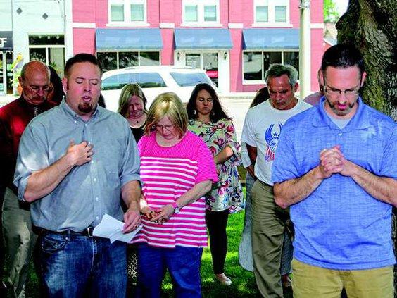 Chris  Moore and Issac Gray pray