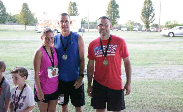 DeKalb Fair 5K winners 3rd-Emily Davis 2nd-Danny Mayo 1st-Josh Miller RV photo.JPG