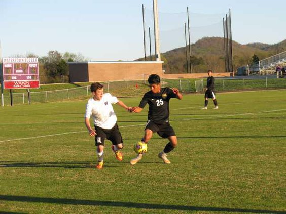 25 Pablo Juarez sends the ball up to the forwards and  4 Regan Foutch is backing up the play..JPG