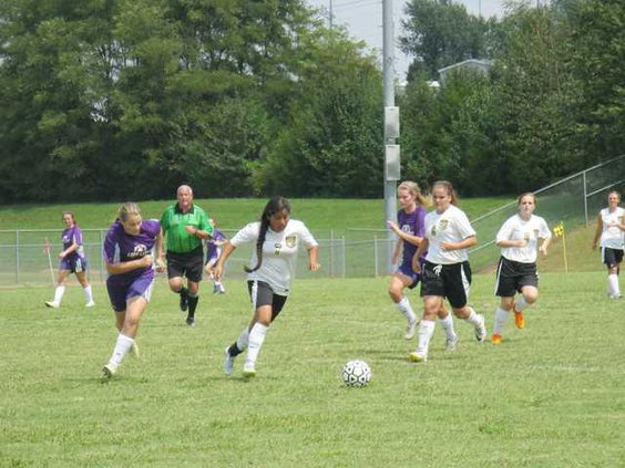 7 Angeles Soto  9 Katie Hall and  6 Sarah Starnes taking control of the ball..JPG