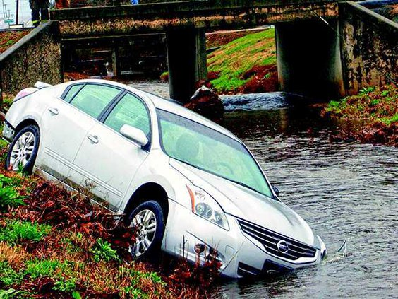 car in creek 1