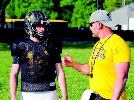 Coach Steve Trapp talks to Conner Vaughn
