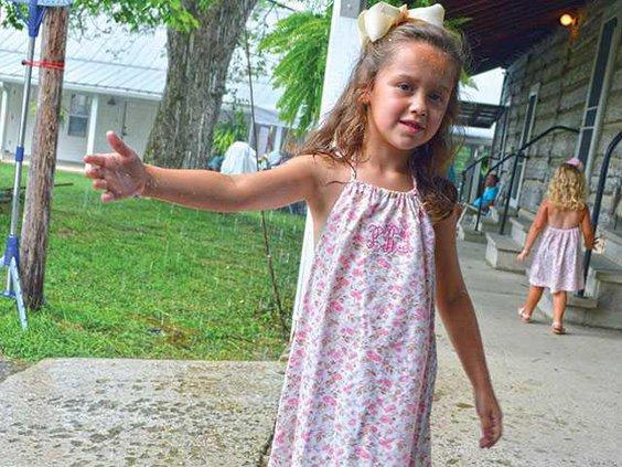 girl-playing-in-rainWEB