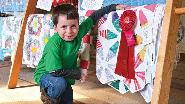 rotator-1--boy-with-quilt