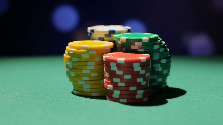 dealers-hands-taking-pile-of-poker-chips-off-the-table-atmosphere-in-casino_spvkvf8q__F0000.png