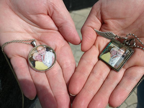 faces of victims- hands and photos.jpg