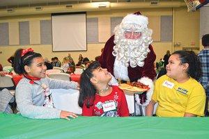 STYLE-Breakfast with Santa-Serving Santa2.jpg