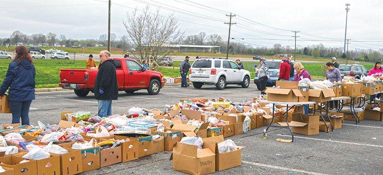 free food - volunteers loading up boxes.jpg