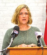 Andrea Fox at press conference.jpg
