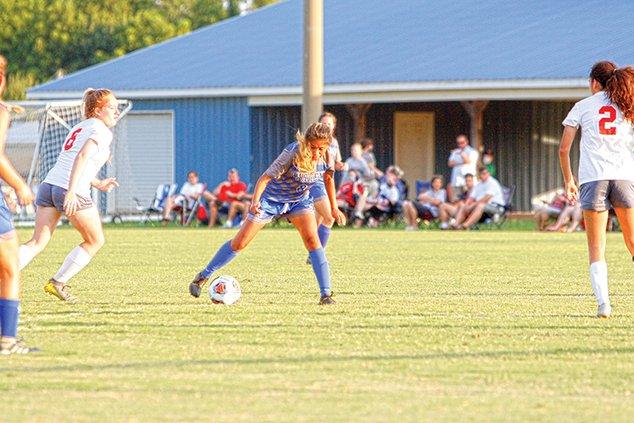 WCHS Soccer - Carmen Verdel kicking ball.jpg