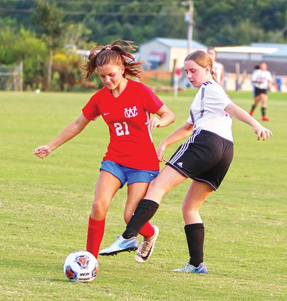 WCMS Soccer 21 Marlee Sliger kicking ball vs Tullahoma 9-8.jpg