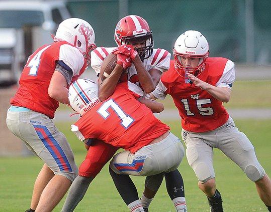 WCHS junior varsity - gang tackle.jpg