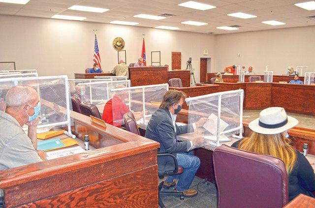 County meeting with plexiglass.jpg