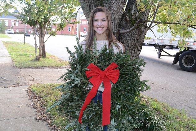 Samantha Jennings with wreath.jpg