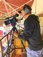 Noah Manus filming basketball game.jpg