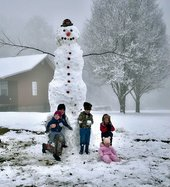 12 Foot Snowman - Joslyn family and snowman.jpg