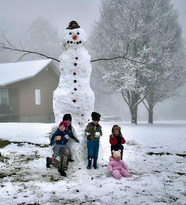 12 Foot Snowman - Joslyn family and snowman.jpg