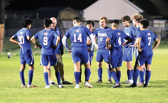 Coach Jackson and Team discussing PK Strategy 3-30.jpg