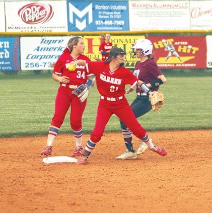 Alyssa Mosley steps on 2nd and makes the throw to First 4-9.jpg