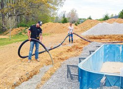 Concrete pump - pouring footer.jpg