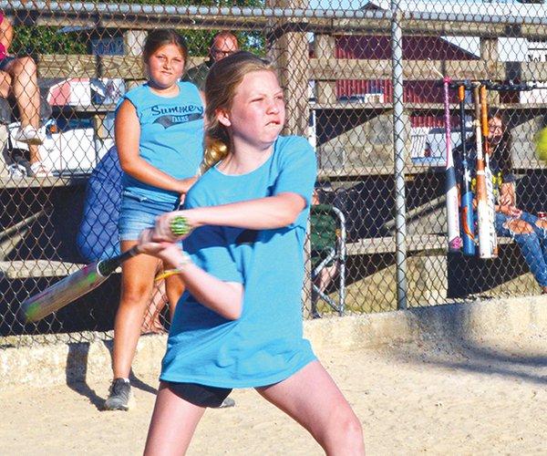 Girl hitting 2.jpg