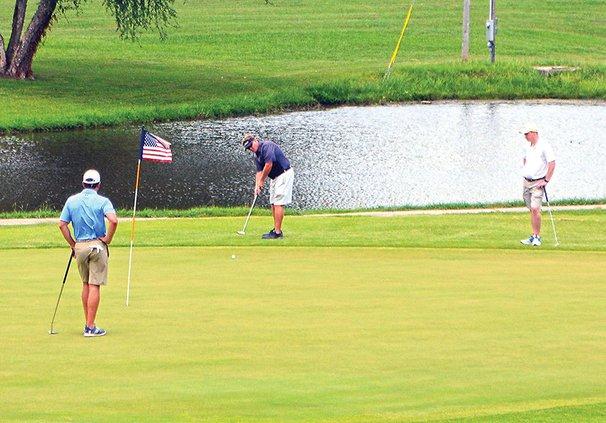 Golf - winning team in action.jpg