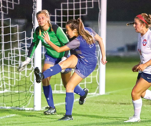 Natalie Stephien Kicking Ball Away from Net 9-1 fixed.jpg